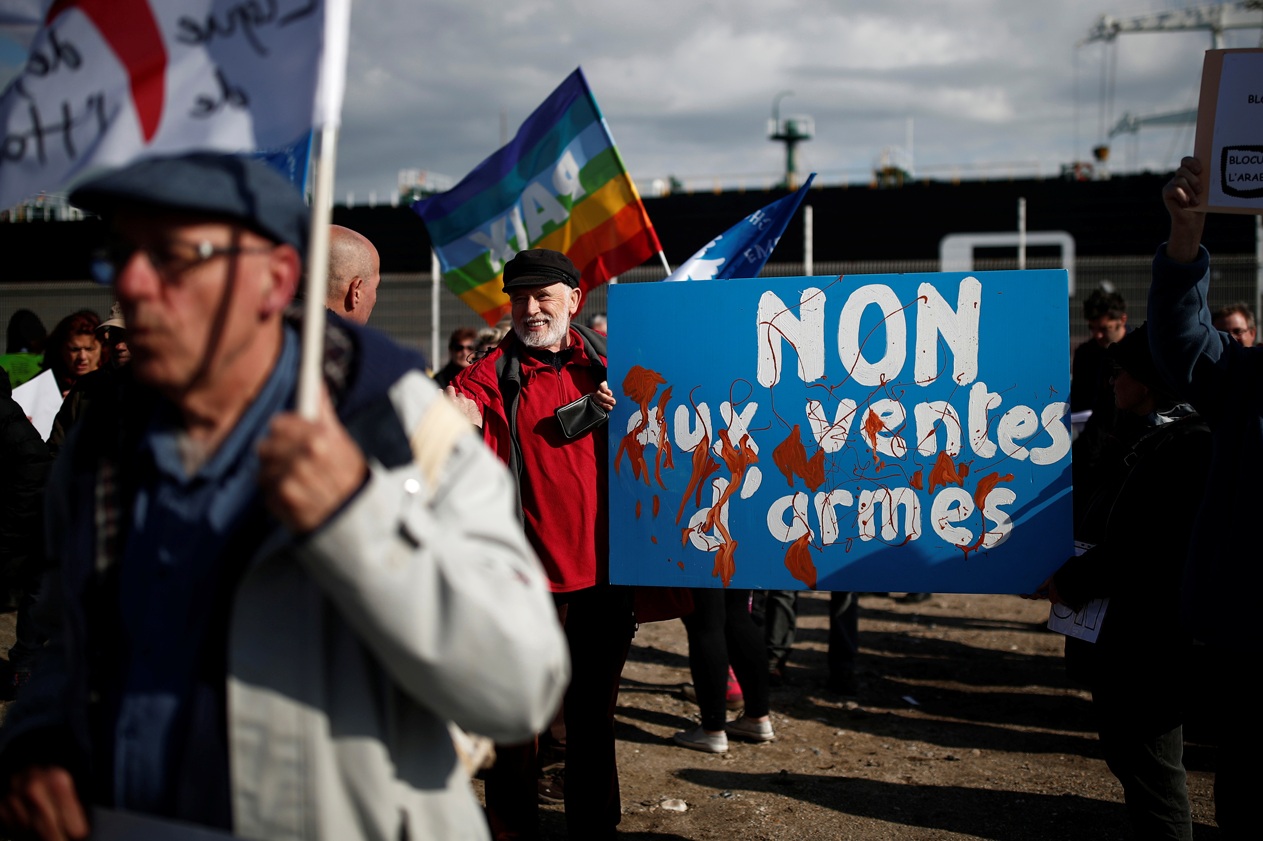 """People attend a demonstration to protest against the loading of weapons aboard the Bahri-Yanbu, a cargo ship operating for Saudi Arabia's defence and interior ministries, in Le Havre, France, May 9, 2019. The banner reads: """"No to arms sales""""."""