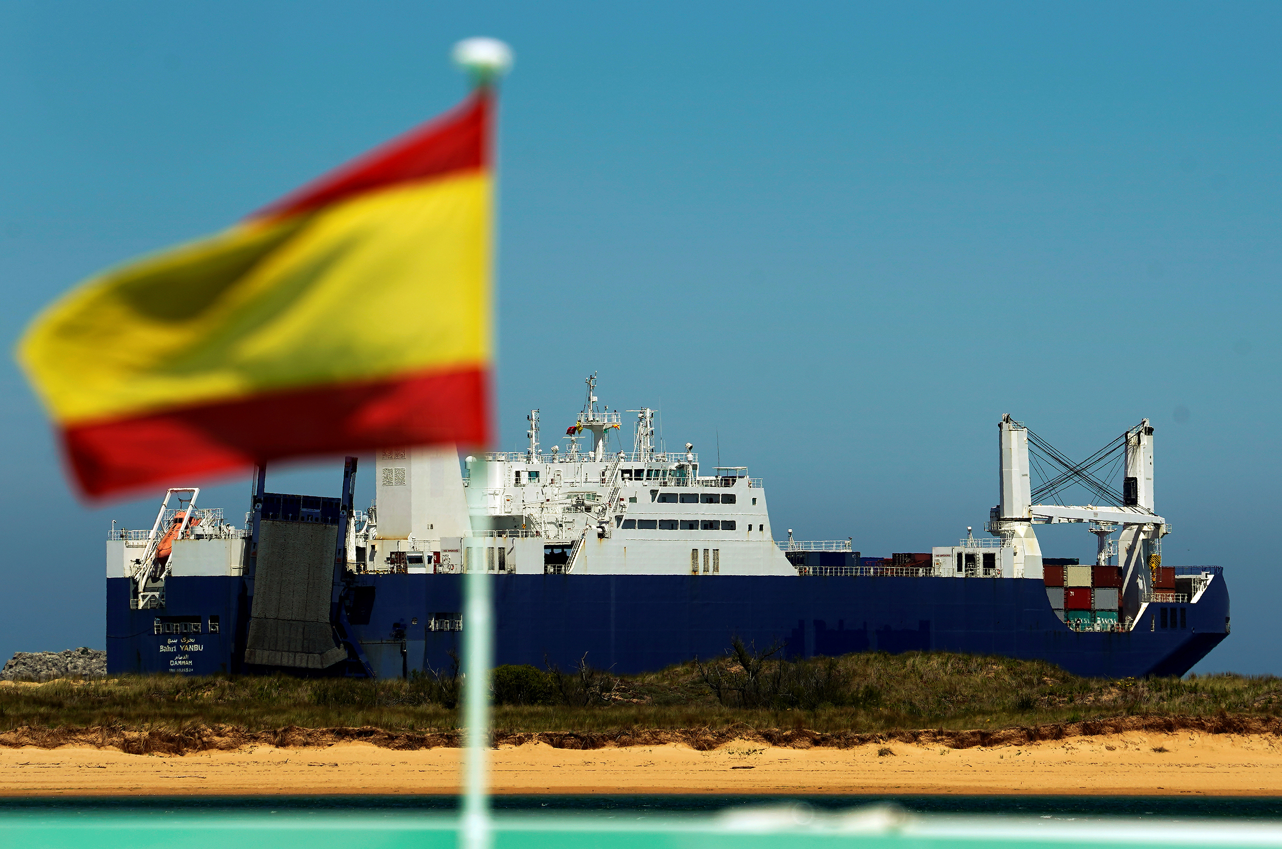 Saudi cargo ship Bahri-Yanbu passes a Spanish flag while departing the port of Santander, Spain May 13, 2019, after a human rights group sought to block the loading of a weapons cargo in Le Havre on humanitarian grounds, arguing the arms could be used against civilians in Yemen.